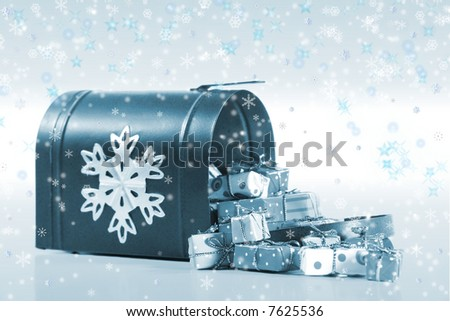 Special Delivery: A wintry mailbox spilling over with gifts and the magic of the holiday season. - stock photo