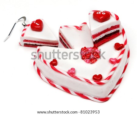 special earrings with a cake in the form of a heart isolated with shadows