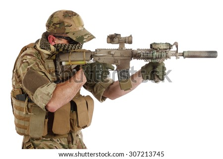 special forces operator with assault rifle on white background