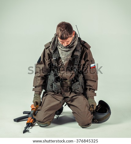 Special forces soldier with rifle on white background - stock photo