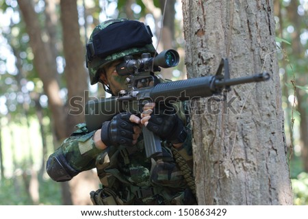special forces soldiers in forest - stock photo