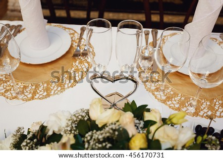 Special goblets for the newlyweds on the wedding table - stock photo