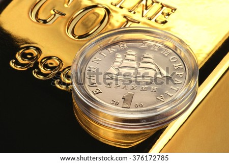 special gold issue of the Greek 1 Drachma coin (translation: Hellenic Republic / 1 Drachma) - stock photo