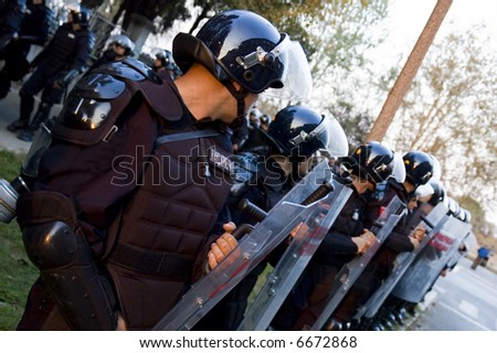 Special police forces cordon at the demonstration, blocking street protests - stock photo