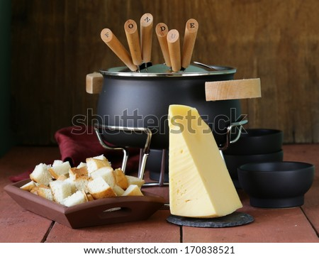 special set of utensils for cooking fondue (cheese, chocolate) - stock photo