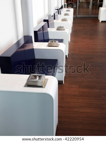 Special smoking-room at the airport - stock photo