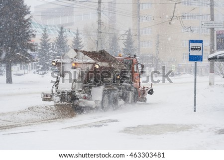 Special technique removes the snow from the street during a snow storm in poor visibility. Snow storm in the city of Cheboksary, Chuvash Republic, Russia. 01/17/2016