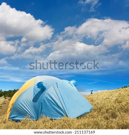 Special tent set on the grassland of high mountain. - stock photo