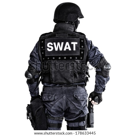 Special weapons and tactics (SWAT) team officer shot from behind - stock photo
