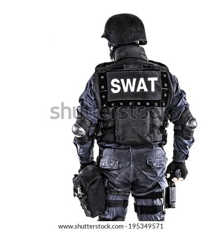 Special weapons and tactics SWAT team officer shot from behind - stock photo
