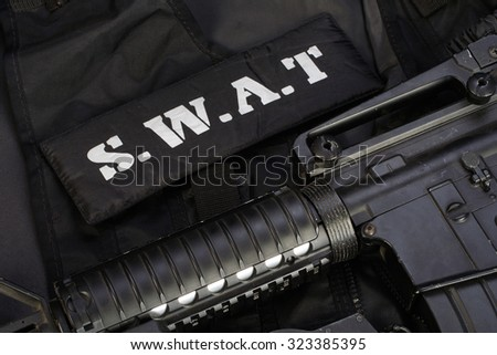 Special weapons and tactics team equipment on black background  - stock photo