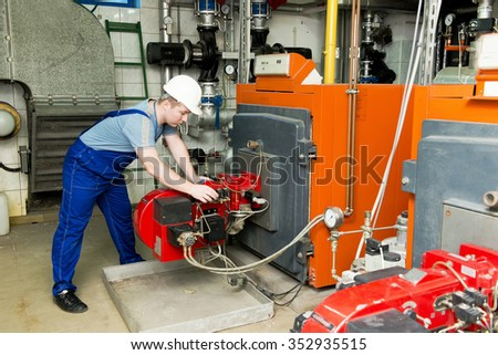 specialist checks the central heating system - stock photo