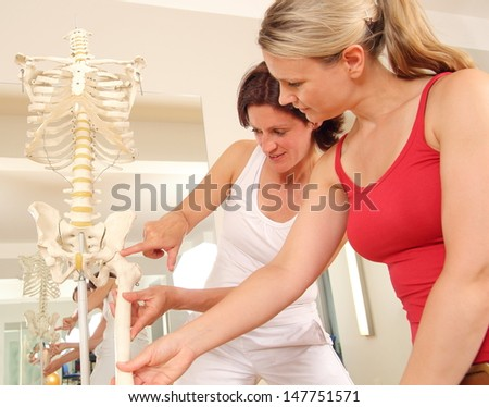 Specialist explaining a hip to a patient - stock photo