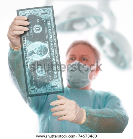 Specialist reviewing dollar x-ray before taking last decision - stock photo