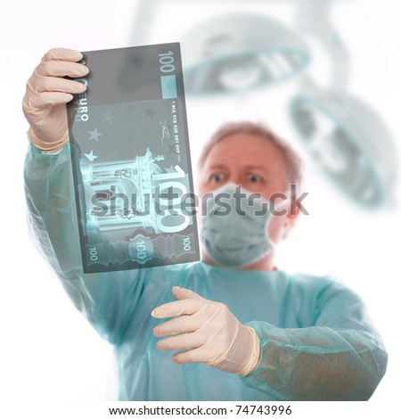 Specialist reviewing euro x-ray before taking last decision - stock photo