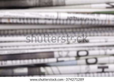 specially defocused stack of newspapers blurred background - stock photo