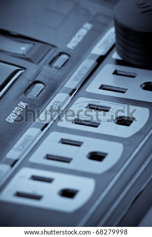 Specially Designated Power Plugs on Surge Protector - stock photo