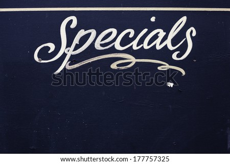 Specials board made of wood and painted black - stock photo