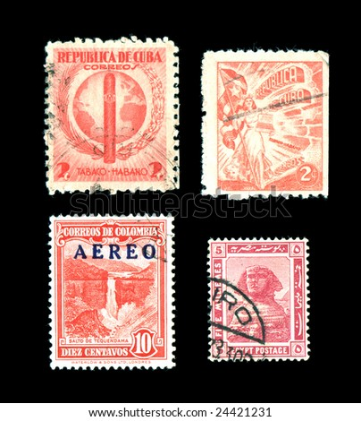 Specialty postage stamps from around the world isolated on black - stock photo