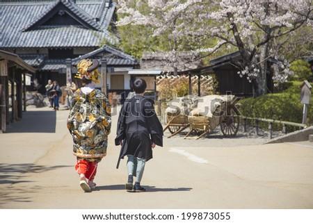 Specific travel image for Nikko,Japan 10 April 2014 : two Japanese couple  in kimono shirt at edo wonderland. - stock photo