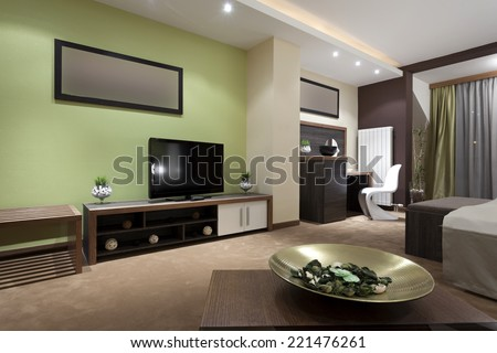 Specious hotel bedroom interior  in the evening - stock photo