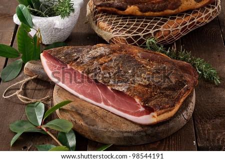 Speck, typical ham Alto Adige, Italy - stock photo