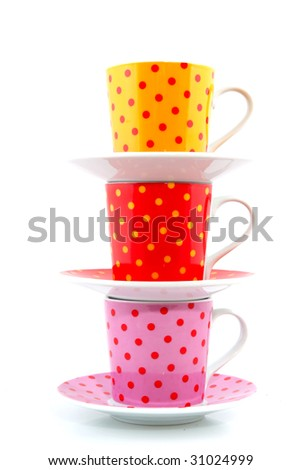 speckles cups and saucers isolated over white - stock photo