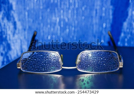 Spectacles of water droplets on the glasses - stock photo