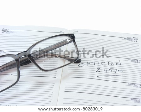 Spectacles on a Diary - stock photo
