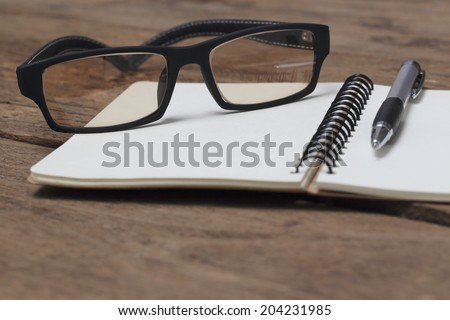 Spectacles on the book - stock photo