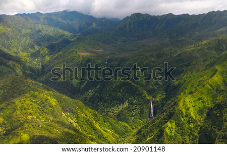 Spectacular aerial view of Manawaiopuna Falls (seen in the movie Jurassic Park) and more distant waterfalls in Kauai's green upcountry,