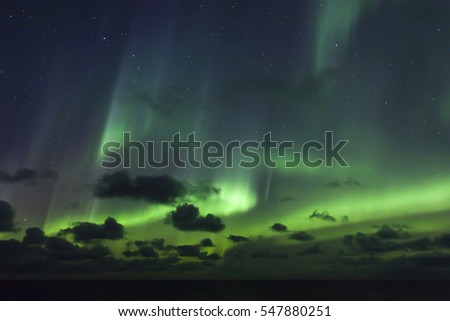 Spectacular Aurora Borealis (Northern lights) over Arctic Ocean