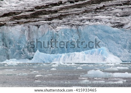 spectacular calving glacier - stock photo