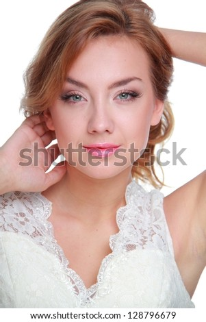 Spectacular fashion model girl in wedding dress is posing over white background/Portrait of beautiful loving young girl