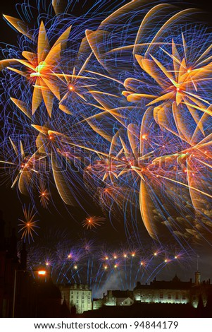 Spectacular fireworks over Edinburgh Castle, Scotland celebrating Hogmanay (that is New Year) - stock photo