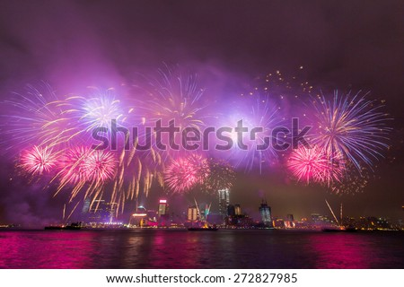 Spectacular Fireworks over Victoria Harbor in Hong Kong - stock photo