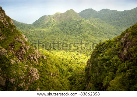 Spectacular forest landscape with mountain range - stock photo