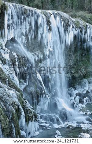 spectacular frozen waterfall in winter - stock photo
