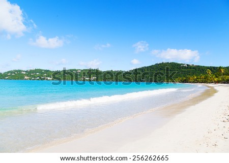 Spectacular Magens Bay beach in the morning on St Thomas Island, US VI. Scenic beach view with palms, white sand and rolling waves.  - stock photo