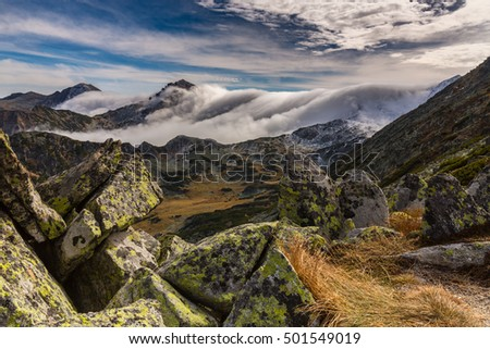 Spectacular mountain scenery in the Alps, with sea of clouds in autumn winter