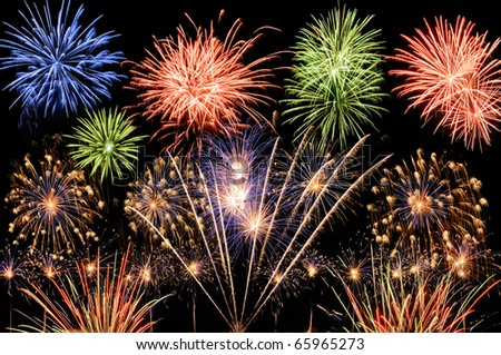 Spectacular multi-colored fireworks celebrating the New Year, the Independence Day or any other great event - stock photo