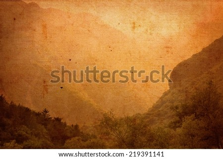 Spectacular old vintage image on canvas material of misty mountainous valley scenery in the Italian lake district. Grungy vintage sepia background with texture - stock photo
