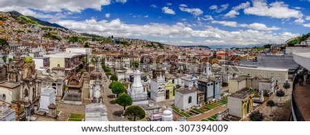 Spectacular overview of cemetery San Diego showing typical catholic graves with large gravestones and old city background. - stock photo