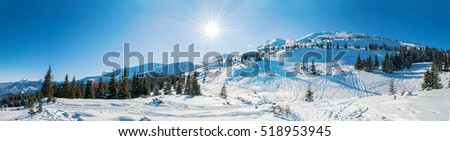 Spectacular panoramic view over the snowy mountains