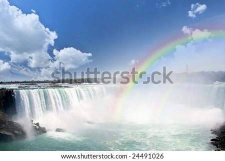 Spectacular rainbows at Canadian side of Niagara Falls - stock photo