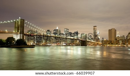 Spectacular skyline of Downtown Manhattan including the Brooklyn Bridge - stock photo