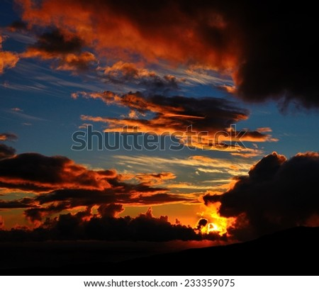 Spectacular sunrise among the clouds - stock photo