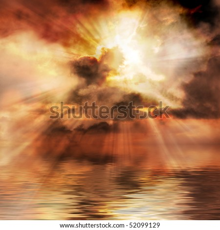 Spectacular sunrise bursts through clouds over water