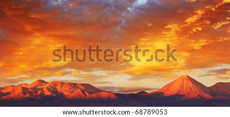 spectacular sunset in Moon Valley in Atacama of Chile - stock photo