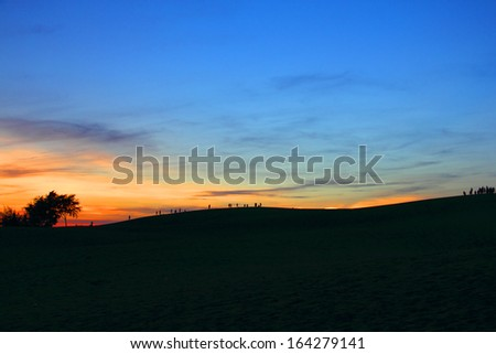 Spectacular sunset over the sand desert - stock photo